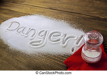 Danger of too much salt – Health Hazard - DANGER written on ...