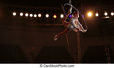 Danger performance - A girl stands in the circus performs...