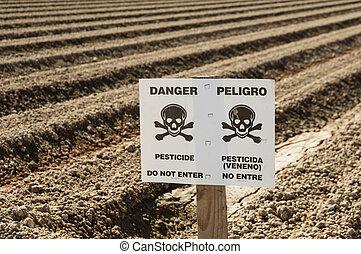 Danger Pesticide Sign In Field - danger pesticide sign in...