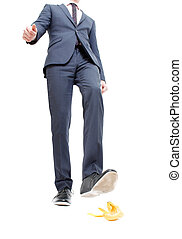 Danger - A business man about to step in banana peel