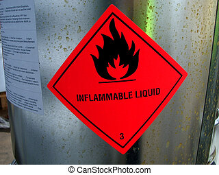 Red warning sign on chemical drum