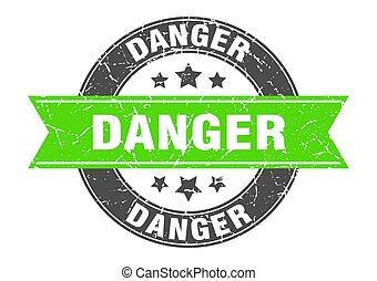 danger round stamp with green ribbon. danger
