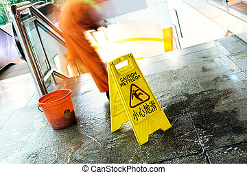 Danger Sign 'Caution'in Progress - cleaning in progress, and...
