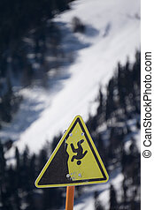 danger steep cliff mountain sign,