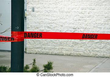 A red danger tape on a construction site