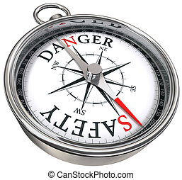 danger vs safety opposite ways conceptual image with compass...