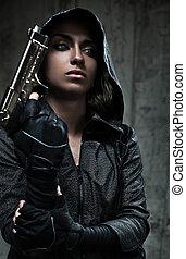 Danger woman with gun. Dark colors.