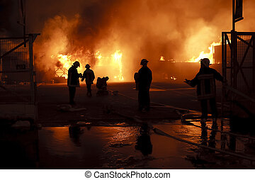 Danger work - Silhouette of firefighters