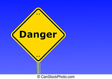 danger written on a yellow road warning sign...