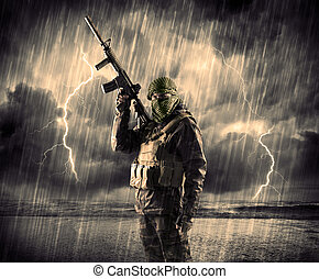 Dangerous armed terrorist with mask and gun in a thunderstorm with lightning