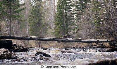 dangerous bridge across the mountain river