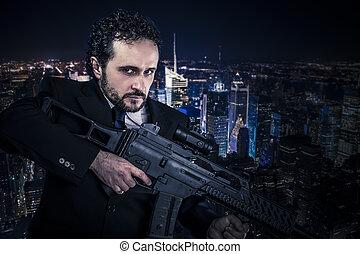 Dangerous business man  concept, armed  with machine gun