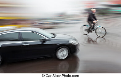 Dangerous city traffic situation with a cyclist and cars in...