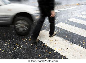 dangerous crossing - Man on pedestrian crossing in autumn,...