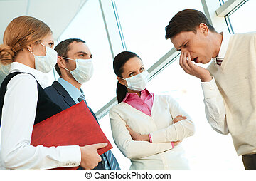 Dangerous disease - Group of co-workers in protective masks...