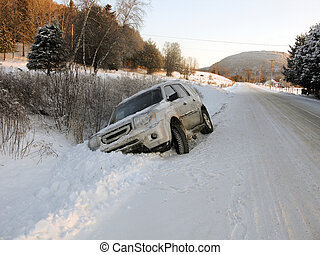 Sports utility vehicle off the road due to icy road conditions
