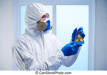 Dangerous experiment - Scientist in protective overall,...