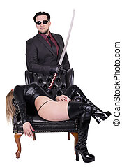 Dangerous killer with katana and woman lying down in chair