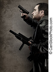Dangerous man armed with a pistol and machine gun