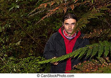 dangerous man - A dangerous looking man hidden in a dark...