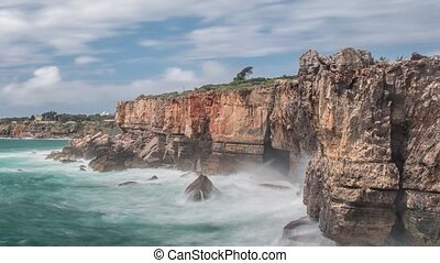 Dangerous ocean waves crash into cliff, Devil Mouth (Boca do Inferno), Portugal