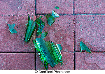 Dangerous shards of glass. Broken bottle on the sidewalk