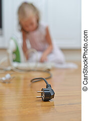 Dangerous situation at home. Child playing with electricity.