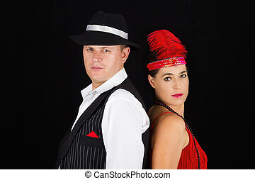 Dangerous standing bonny and clyde gangsters with 1920 style clothes standing