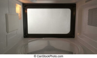 Dangerous turning on an empty microwave with nothing inside it