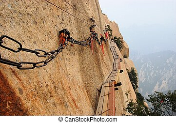 Dangerous walkway at top of holy Mount Hua Shan, China -...