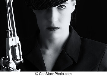 Dangerous woman in black with silver handgun and stylish hat...
