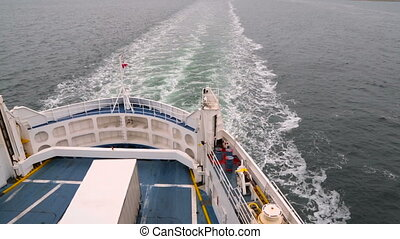 Danish flag fluttering in the wind on the ship