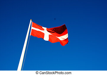 Danish flag waves in the breeze on a summer day