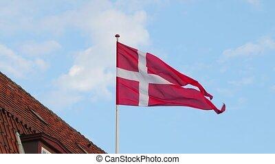 Danish Flag Waving - Flag of Denmark waving on a building