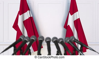 Danish official press conference. Flags of Denmark and...