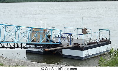 Danube Pontoon - Danube river wharf for ships docked. Small...