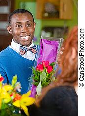 Dapper Man in Flower Shop Buys Roses