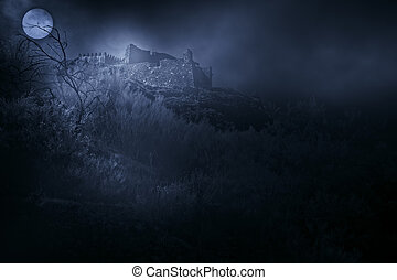 Dark ages - Old european castle in a foggy full moon night