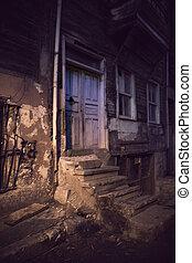 Dark alley in spooky light - Dark alley with door and cement...