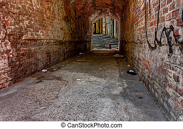 dark alley - dirty underpass in the old town - dark, narrow...