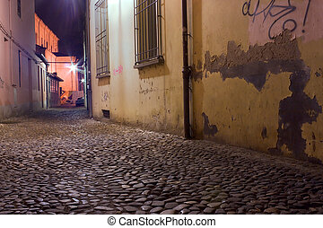 dark alley - dirty alley at night in the city with pavement...