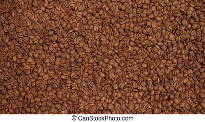 Dark and aromatic coffee beans background stock footage...