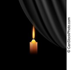 dark and candle - black background and a small burning...