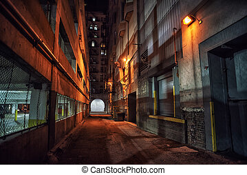 Dark and eerie downtown urban city alley with a loading dock nex