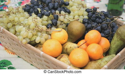 Dark and green grape, oranges, pears in wooden box - Dark...