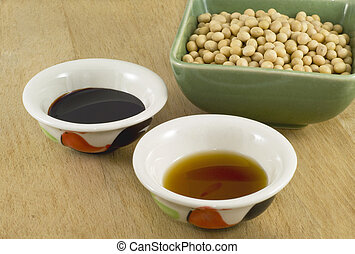 Dark and light soy sauce with soy beans.