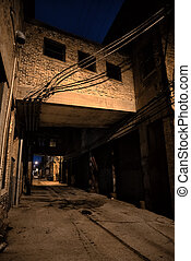 Dark and scary downtown urban city street alley scene with an ee