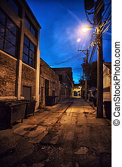 Dark and scary downtown urban city street alley with an eerie vi