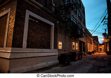 Dark and scary downtown urban city street corner alley with an e