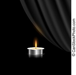 dark and small candle - black background and a small burning...